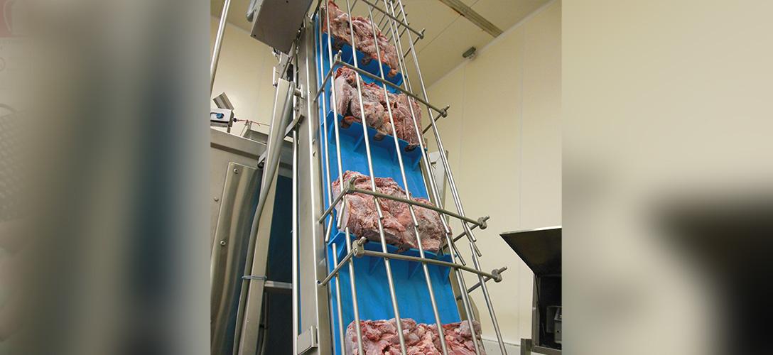 Frozen meat blocks elevator